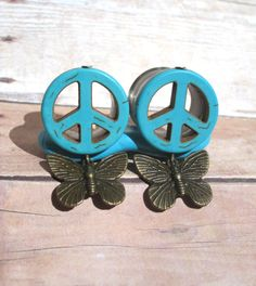Hey, I found this really awesome Etsy listing at http://www.etsy.com/listing/153049737/pair-of-turquoise-peace-sign-tunnels