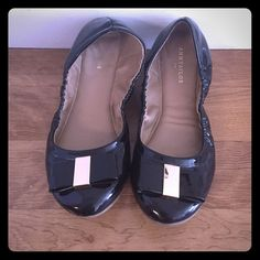 Ann Taylor Black Flats Ballet flats with black and gold bow. Middle of shoe is stretchy. Have been worn a few times, but it overall good condition. Ann Taylor Shoes Flats & Loafers