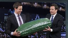 Jimmy Fallon passes the 'Late Night' pickle to Seth Meyers