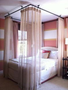Ceiling hung curtains around bed