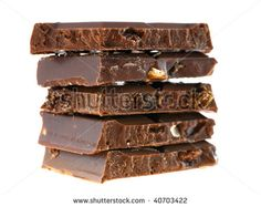 Stack of milk chocolate pieces with nuts and raisins on white background