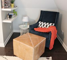 Modern glider - love how this is paired with a leather ottoman! #nursery
