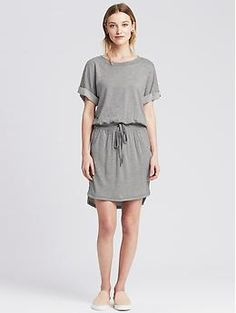 Gray Sweatshirt Dress has ribbing at waist with grommets for drawstring, also ribbing at neck, front off-seam pockets