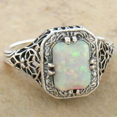 This Beautiful Piece Has An Antique Finish & Is Set With The Highest Quality 8 x 6 mm Lab White Opal Stone. Made From The Original Designs Of The Victorian To The Art Deco Period, Raw Gemstone Jewelry, Opal Jewelry, Costume Rings, White Lab, Halo Engagement Rings, Raw Gemstones, Art Deco Design, Opal Rings, Vintage Costumes