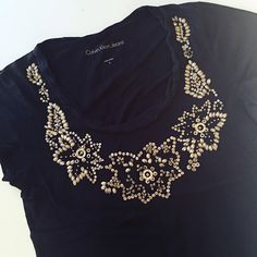 Calvin Klein Jeans embellished tee Soft and casual, but still with flair!  Gold beads and sequins around neckline. Great condition. Calvin Klein Tops Tees - Short Sleeve