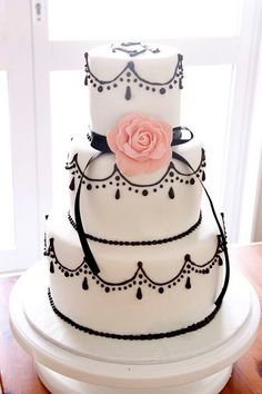 Black and white cake, maybe a red flower in the front!