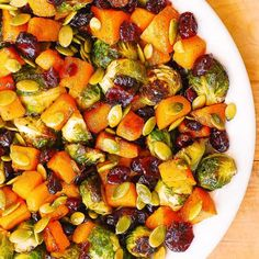 Maple Butternut Squash, Roasted Brussels Sprouts, Pumpkin Seeds, and Cranberries – perfect Autumn salad, bursting with colors and flavors! I love this reci Sprouts Salad, Brussel Sprout Salad, Brussels Sprouts, Vegan Brussel Sprout Recipes, Butternut Squash And Brussel Sprouts Recipe, Vegan Butternut Squash Recipes, Roasted Sprouts, Pumpkin Seed Recipes, Healthy Recipes