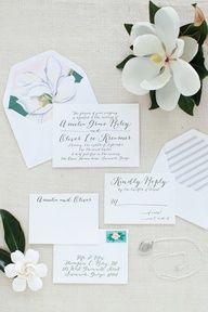 wedding invites , pastel magnolia (mint leaves, white petals -pink-yellow center)