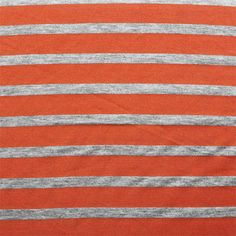 Small Heather Gray and Red Orange Stripe Cotton Jersey Blend Knit Fabric - A striking red orange color stripe and heather gray small stripe on cotton jersey poly rayon blend knit.  Fabric is soft with a nice drape and stretch, light to mid weight.  Heather gray stripe measure 1/2