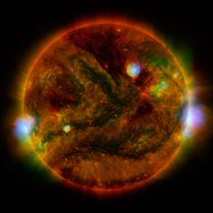 Searing Sun Seen in X-rays - July 8, 2015 - Flaring, active regions of our sun are highlighted in this new image combining observations from several telescopes. High-energy X-rays from NASA's Nuclear Spectroscopic Telescope Array (NuSTAR) are shown in blue; low-energy X-rays from Japan's Hinode spacecraft are green; and extreme ultraviolet light from NASA's Solar Dynamics Observatory (SDO) is yellow and red. Credits: NASA - http://www.nasa.gov/nustar  http://www.nustar.caltech.edu