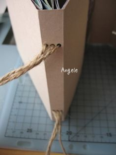 This shows how three registers are bound into the mini album. Click the pic for the tutorial. Easy binding alternative.