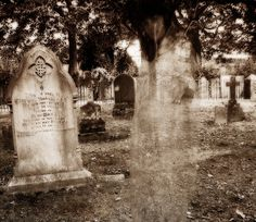 Cemeteries Ghosts Graveyards Spirits:  A ghost in a cemetery.