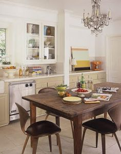 mid century modern chairs, rustic farm house table and crystal chandelier