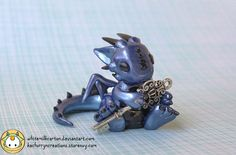 Baby dragon holds the key to your heart. Polymer clay. (click thru for artist's DeviantArt page)