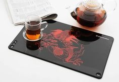 Even decorations can be digital. Designed by Rodrigo Wolff, these digital placemats are made of flexible screens that can be rolled like paper. Using the internet, a digital camera or any other storage device, images can easily be transferred to the placemats.