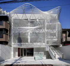 amano design office transforms tokyo office with contorted façade
