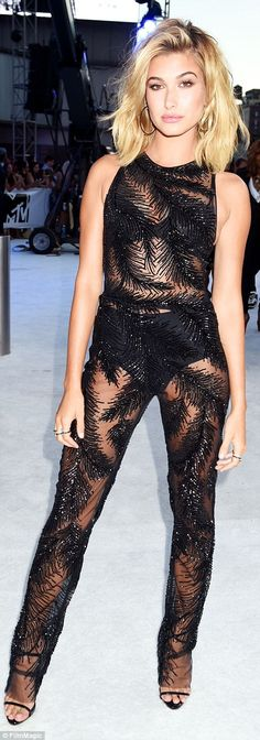 Stunning: Model Hailey Baldwin dazzled in a sparkly sheer Georges Chakra jumpsuit