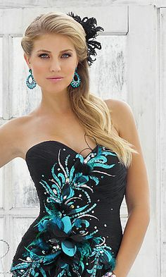 Long strapless black gown with blue embellishment by Blush.
