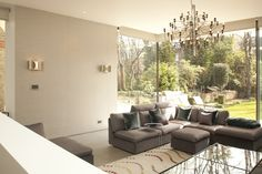 Maida Vale, London - KR Interior Sophisticated conservatory, large angle sofa, shades of grey, warm light