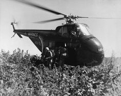 U. S. Marines of the First Marine Div. Reconnaissance Co. make the first helicopter invasion on Hill 812, to relieve the ROK Eighth Div., during the renewed fighting in Korea. September 20, 1951. T. G. Donegan. (Navy)