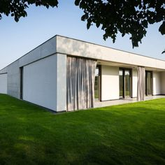 This modern Czech home in Olomouc-Slavonin has three wings, which create a U-shaped floor plan, plus an inner atrium and minimalist furnishings. Minimalist Architecture, Contemporary Architecture, Atrium, Residential Architecture, Interior Architecture, Outside Curtains, Beautiful Interior Design, Detached House, Modern Minimalist