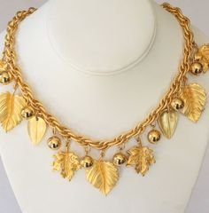 Napier Heavy Ornate Leaf Charm Necklace- This marvelous necklace features gorgeous gilted gold leaves and stunning gold berries that shine like the sun!