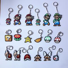 Super Mario keychains, pins, magnets or earrings! Made with Hama mini beads. Perler Bead Mario, Pokemon Perler Beads, Diy Perler Beads, Pearler Beads, Pearl Beads Pattern, Hama Beads Patterns, Beading Patterns, Super Mario, Perler Bead Templates