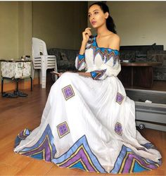 Image may contain: 1 person, standing Ethiopian Wedding Dress, Ethiopian Dress, Traditional Wedding Dresses, Traditional Outfits, African Wear, African Dress, Habesha Kemis, Ethiopian Traditional Dress, White Sheath Dress