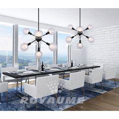 Suspendu noir additionné de globe double de couleur claire. Épuré et aérien ce luminaire est parfaitement conçu pour ajouter une touche moderne, idéal pour salle a manger, chambre, entrée et ilot.