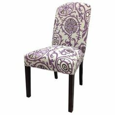 """Highlighted by flowing purple medallions, this pair of Parsons-style side chairs is highlighted by cotton upholstery, foam cushioning, and wood frames. Product: Set of 2 chairsConstruction Material: Wood and fabric upholsteryColor: Purple and white       Dimensions: 41"""" H x 21"""" W x 24.5"""" D each  Cleaning and Care: Clean with a soft cloth"""