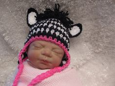 Crochet Baby Zebra Ear Flap Hat - Photo Prop - made to order. (doll head is kinda creepy but I luv the little hat!)
