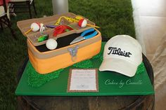 Sculpted tackle box fishing cake with titleist baseball cap, grooms cake