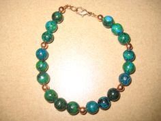 Azurite-Malachite beads with Copper spacer beads.  $45.00