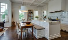 Stunning House Tour - Its Overflowing. Like the design of the table off the island.