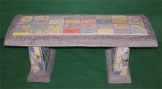 Tiled Garden Bench: Kara & Eric's third graders each designed their own tile to decorate this cement garden bench. The charming and colorful tiles reflect their ideas about the importance of learning