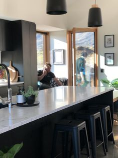 Black Kitchen, naturals light filled, marble bench top, window seat. Queenstown build, Jacks Point. Black Kitchens, Windows, Architecture, Building, Table, Bench, Furniture, Home Decor, Arquitetura
