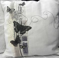 This pretty cushion is made from a cream cotton, collaged with toning fabrics and lace, then machine embroidered. The butterflies are printed and then appliquéd. The cushion has a non. Butterfly Cushion, Applique Cushions, Freehand Machine Embroidery, Thread Art, Fabric Art, Handmade Crafts, Needlework, Quilts, Pillow Talk