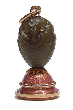 An Imperial desk seal by Carl Fabergé, the handle naturalistically carved from a single piece of brown agate in the form of an owl, its eyes set with rose diamonds, with chased gold claws, stood on a gold mount enamelled translucent pink over an engraved ground, with a circular uncut gold seal. Workmaster Fedor Afanassiev, St. Petersburg, 1908-1917. Provenance: Purchased by the Dowager Tsarina Marie Feodorovna from Fabergé in St. Petersburg on 15th April 1910 for fifty-five roubles.