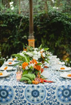 Blue/white table linen with orange, white and green florals.