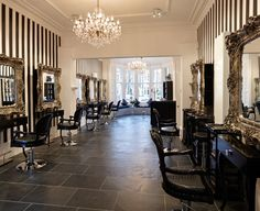 black & white stripes, baroque mirrors and crystal chandeliers. Looks like my house :)