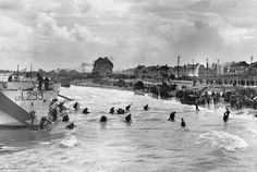 Men of Canadian 9th Infantry Brigade disembarking from LCI(L) landing craft onto Nan White Beach near Bernières-sur-Mer Juno Beach Normandy France late morning 6 June 1944.