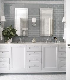 Heather Garrett Design - bathrooms - gray subway tile, granite counter top, shaker cabinets, <3 mirror framed mirrors