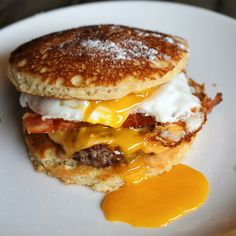"Pancake sliders: American cheese, bacon, and a sunny side egg between syrup-infused pancake ""buns"""