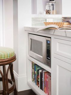 Clean Countertops  The homeowners maximize every inch of counter space by putting the microwave in a custom-made cabinet, which is the perfect height for small children, and by stashing cookbooks on the shelf below. Keep clutter to a minimum to make a small kitchen feel open and spacious.: