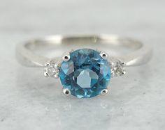 Sweet and Simple Ladies Three Stone Blue Topaz Ring 0HPY8J
