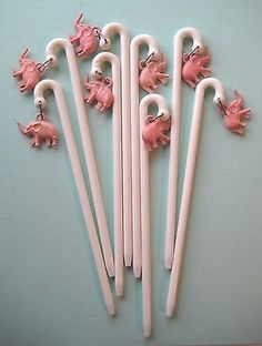 The Brief History of Swizzle Sticks (Cocktail Stirs) and images of various vintage versions.Plan the Perfect Cocktail Party with Swizzle Sticks. Vintage Bar, Vintage Pink, Vintage Items, Pink Elephants On Parade, Cocktail Accessories, Elephant Home Decor, Stir Sticks, Elephant Love, Retro Home