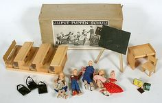 Liliput-Puppen-Schule (Liliput doll school) by German firm of Erna Meyer, ca. 1960's.  Original box, blackboard, teacher's desk and chair, single student desk, 3 two-person attached desks, 3 girl students, 1 boy student, 1 teacher, and accessories.