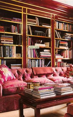 Couch in front of book shelves