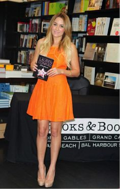 Lauren Conrad wearing an orange dress at a Book Signing in Florida http://findanswerhere.com/womensfashion