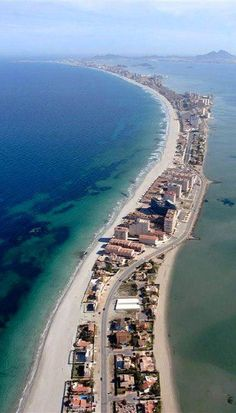 """La Manga del Mar Menor (meaning """"The Sandbar of the Minor Sea"""") is a seaside spit in the Region of Murcia, Spain. Beautiful Places In The World, Places Around The World, Wonderful Places, Around The Worlds, Amazing Places, Beautiful Roads, It's Amazing, Cool Places To Visit, Places To Travel"""